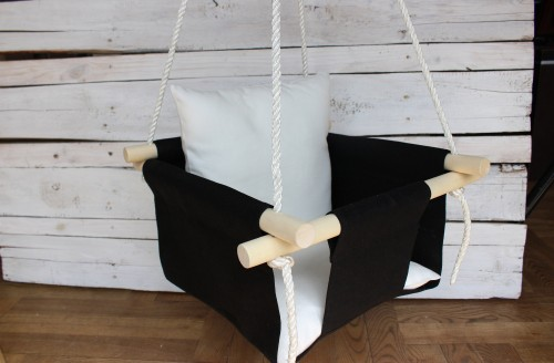 Black Swing for baby with white pillow