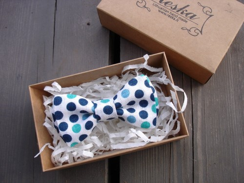 White bow tie with blue polka dots